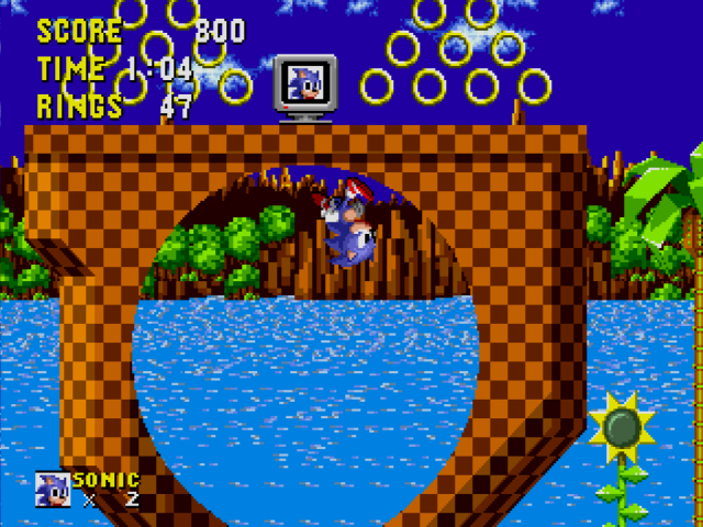 Sonic the Hedgehog - Sonic powers through a loop in Green Hill Zone.